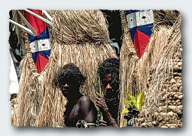 Dancers in the Solomon Islands. One is a high placed government official. ©